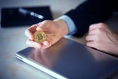 Bitcoin coin in hand stock photos