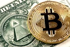 Bitcoin coin on one dollar Stock Image
