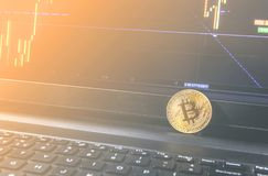 Bitcoin coin placed on modern black notebook . Close-Up photo Bitcoin , exchange virtual value, crypto digital . stock photography