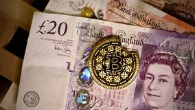 Bitcoin coin and pound sterling stock photos
