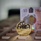 Bitcoin coin and pound sterling royalty free stock photos