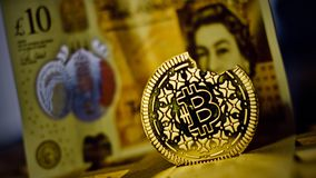Bitcoin coin and pound sterling stock photography