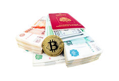 Bitcoin coin and stacks of russian rubles Royalty Free Stock Photos