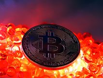 Bitcoin coin on top of red hot burning  beats. Bitcoinc Coin on top of red hot colored burning beats background Royalty Free Stock Photography