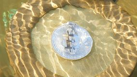 Bitcoin coin under the water. BTC, Bitcoin coin under the water stock video