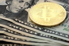 Bitcoin coin on United States US twenty dollar bill $20. Virtual cryptocurrency money Bitcoin golden coin on United States US twenty dollar bill $20 with the royalty free stock photography