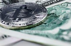 Bitcoin coin on us dollar. Close up stock photo
