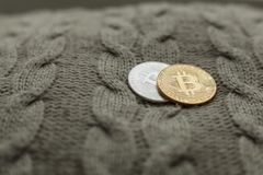 Bitcoin coin on a wool background Stock Photo