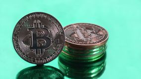 Bitcoin coins close-up on green background stock photo