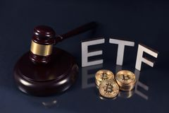 Bitcoins with ETF tekst on dark. Bitcoin coins with ETF text and gavel put on dark background, Concept of the approval of Exchange Traded Fund royalty free stock photos