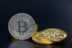 Bitcoin coins in gold and silver Royalty Free Stock Image