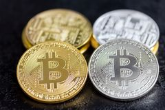 Bitcoin coins in gold and silver Stock Photography