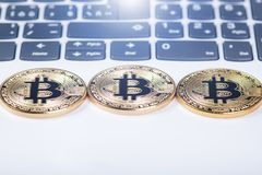 Bitcoin coins on a keyboard of white laptop. Computer. Investment situation. New virtual currency. Most valuable cryptocurrency Royalty Free Stock Photos