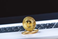 Bitcoin coins on a keyboard of white laptop. Computer. Investment situation. New virtual currency. Most valuable cryptocurrency Royalty Free Stock Images