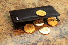Bitcoin coins with the leather wallet on granite background Royalty Free Stock Images