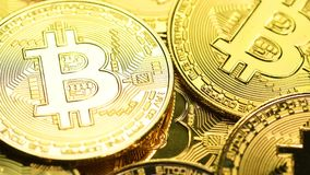 Bitcoin coins macro shot. Bitcoin cryptocurrency. Golden crypto coin, macro shot with shifting focus stock footage