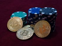 Bitcoin coins and poker chips. New virtual and real currency. Stock Photos