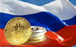 Bitcoin coins on Russia flag, Cryptocurrency concept photo stock photo