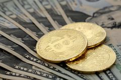 Bitcoin coins on United States US twenty dollar bill $20. Virtual cryptocurrency money Bitcoin golden coins on United States US twenty dollar bill $20 with the stock image