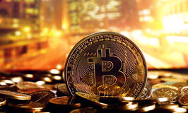 Bitcoin on colorful background. Golden bitcoin on colorful background Royalty Free Stock Photos