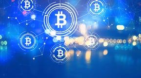 Bitcoin com luzes da cidade na noite Imagem de Stock