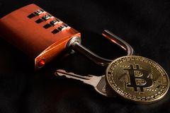Bitcoin, combination lock, key stock photos