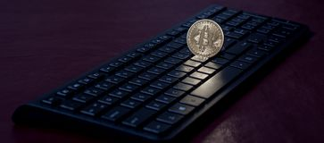 BitCoin on a computer keyboard Royalty Free Stock Image