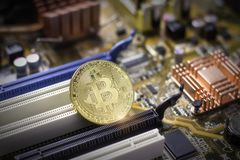 Bitcoin on the computer motherboard royalty free stock photos