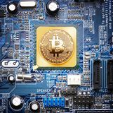 Bitcoin on a processor Royalty Free Stock Photo