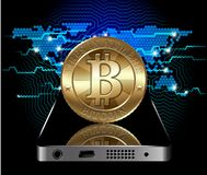 Bitcoin Concept. Cryptocurrency coin at the communication device on digital world map background Stock Photo