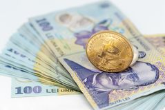 Bitcoin concept coin and stack of romanian currency ron leu over white background. Concept photo Stock Image