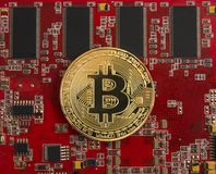Bitcoin concept - gold coin, computer circuit Board. With bitcoin processor and microchips. Electronic currency, Internet Finance Royalty Free Stock Image