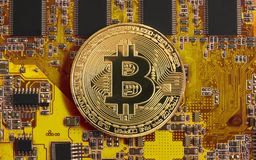 Bitcoin concept - gold coin, computer circuit Board with bitcoin processor. And microchips. Electronic currency, Internet Finance Royalty Free Stock Photos