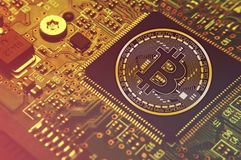 Bitcoin concept - Printed circuit board with bitcoin processor  Royalty Free Stock Image