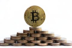 Free Bitcoin Concept, Standing Bitcoin On To Of Other Coin Stacks In Pyramid Shape Stock Photo - 113845250