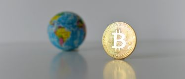 Bitcoin concept. World economy concept. New world currency.Golde. Bitcoin concept. World economy concept. New world currency. Golden coin bitcoin and globe Stock Photo