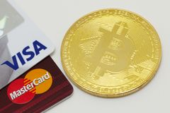Bitcoin and credit cards stock photography