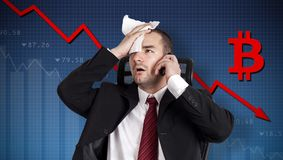 Bitcoin crisis, currency collapse. Broker holding forehead royalty free stock photography