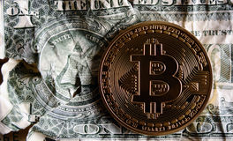 Bitcoin on Crushed dollar banknote. Concept of  Monetary system collapse Royalty Free Stock Photo