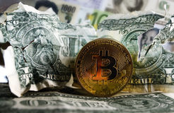Bitcoin on Crushed dollar banknote. Bitcoin on Crushed US dollar and euro  banknotes. Concept of  Monetary system collapse Stock Photo