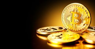 Bitcoin crypto currency. BTC coins on black background Royalty Free Stock Images