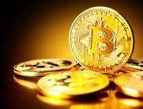 Bitcoin crypto currency. BTC coins on black background Stock Photos