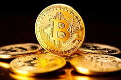 Bitcoin crypto currency. BTC coins on black background Stock Image