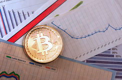 Bitcoin crypto currency  diagram. A golden bitcoin on graph and diagrams  background. concept of trading  crypto currency Royalty Free Stock Image