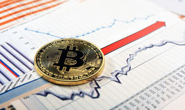 Bitcoin crypto currency  diagram. A golden bitcoin on graph and diagrams  background. concept of trading  crypto currency Stock Photography