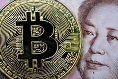Bitcoin crypto currency, digital money in China concept, closed up shot of physical coin with B sign alphabet on face of Chinese. Yuan banknote stock photos