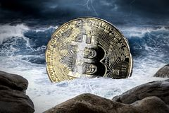 Bitcoin crypto currency financial market crash concept. Bitcoin crisis crypto coin currency finance market crash concept sinking in ocean thunderstorm background stock photography