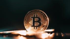 Bitcoin. Crypto currency gold bitcoin BTC. Macro shot of Bitcoin coins isolated on black background Blockchain