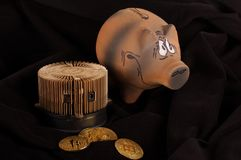 Bitcoin miner, some golden coins and piggy bank for savings. Bitcoin crypto currency savings and earn concept Royalty Free Stock Photo