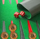 Bitcoin cryptocurrecy gaming board backgammon stock photo